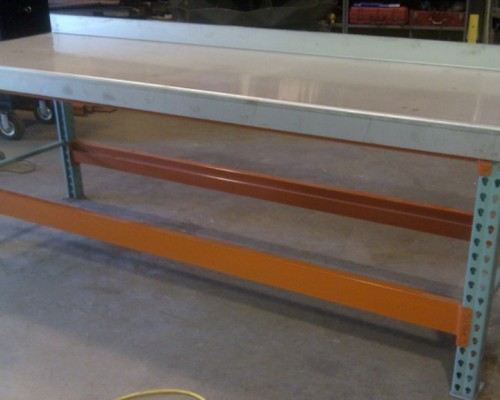 custom crafted tool workbench with steel surface